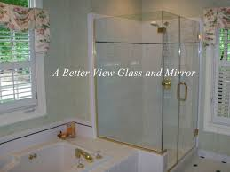 frameless glass shower door with mitered glass edges at corner of glass panel and return glass