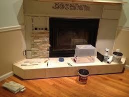 adding stone to new fireplace surround