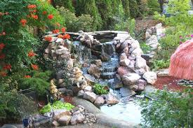 small backyard waterfalls appealing of backyard waterfalls and ponds ideas in the small backyard decorated with garden ornaments and large ornamental plants