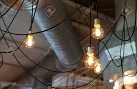 exposed ceiling lighting. Hanging Light Bulb And Black Cable With Exposed Ceiling Background Stock Photo - 40902577 Lighting G