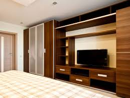 bedroom plaid bedding and tv unit design with wardrobe for wall incredible modern built in designs