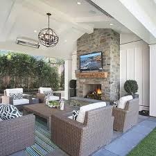 i love outdoor fireplaces see more covered patio vaulted ceiling with fireplace tv