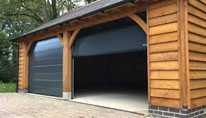 the sectional garage door is fast becoming the most popular door type in the uk and for good reason one of the many benefits of a sectional door is the