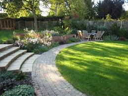harpenden garden design in autumn patio lawn path and steps to upper garden planting includes roses