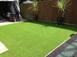 messy garden before artificial grass perfectly green laid garden lawn