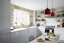 a brick wall and reclaimed timber shelves add character warmth against the modern grey kitchen tile w87 kitchen