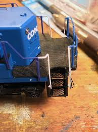 not match the paint on the model look carefully at the handrail stanchions here they almost appear to be purple against the bright conrail blue on