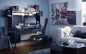 a black workstation with space for two screens speakers and storage on top shown anew office ikea storage