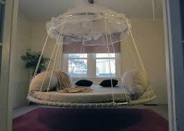 This hanging round bed looks like something out of a fairytale with its  light and airy netting canopy.