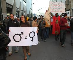 marat a female activist carries a sign promoting gender equality as protesters through downtown rabat calling