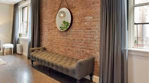 urban living room with brick accent wall design