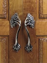 antique chrome door handles for teak wood door designs with creative carving style