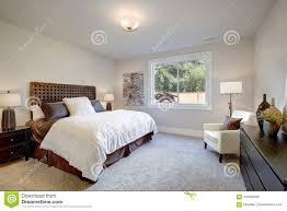 Light Brown And White Bedroom Master Bedroom Interior With King Size Bed Stock Photo