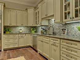 green color kitchen cabinets oak board flooring light brown granite rounded dining table metal chrome hood