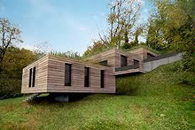 maison bois toit plat terre en