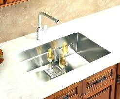 granite countertops with overmount sink under mount composite quartz above on over