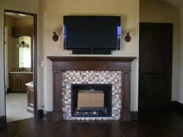 mosaic tile fireplace surround terranean bedroom