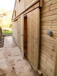 ideal range american barn sliding door with personal door
