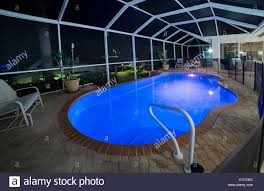 inground pools at night. Night View On Home Inground Pool In The Yard With Protective Mesh, South Florida, Pools At