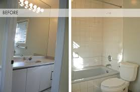 the before of this bathroom was your typical builders basic laminate countertop standard tiles unframed mirror and the fabulous strip of disco lights basic bathroom strip