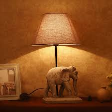 vase lighting ideas. Black Base Indoor Table Design Craft Lighting Above White Framed Picture And Small Elephant Statue Also Vase Ideas