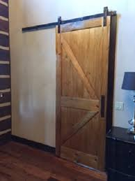 this door is made from pine and constructed using stave cores for ility the door was color matched to an existing sle door provided by the customer
