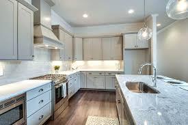 arctic white quartz. Kitchen Dark Grey Cabinets Transitional With Gray Arctic White Quartz And Snowfall Granite Subway Tile Globe C