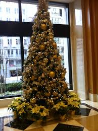 Gold Christmas Tree In Office Building Lobby Gold