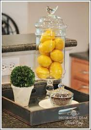 decor kitchen kitchen: cute decorating idea for kitchen table glass container thinking home store here fill with lemonsthinking you could fill with pumpkins for fall