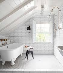attic bathroom with subway tile walls and shower head also clawfoot bathtub with stool and free