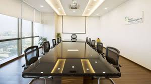 white and brown large boat shaped and small round tables conference meeting room tables