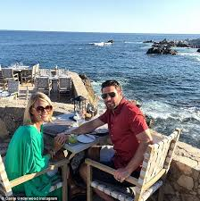 so happy together carrie underwood held her husband s hand in this snap taken in cabo
