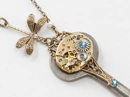 steampunk antique skeleton key necklace with gold watch aquamarine crystal pearl and dragonfly pendant filigree statement