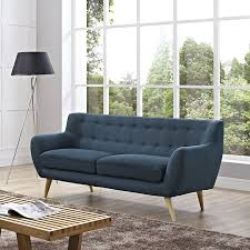 the well appointed house luxuries for the home the well appointed home mid century modern dark blue upholstered sofa with natural wood dowel legs