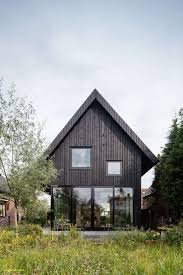 dutch gable roof new chris collaris architects builds black wooden cote with