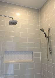 cost to install bathroom wall tile lovely linear light gray shower wall tile with hexagon mosaic