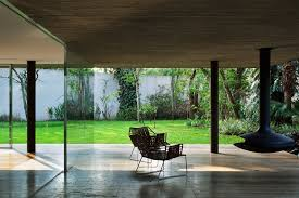 A free first floor with large sliding glass doors which support a wooden box delimited by concrete&nbsp. Toblerone Studiomk27