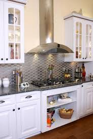 gas stove top cabinet. Elegant Kitchen Design With Open Cabinets Below The Gas Stove Top And Patterned Stainless Steel Tile Backsplash Metallic Finish Also White Wooden Cabinet N