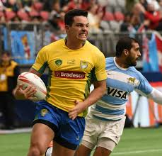 brazil yellow controls the ball against argentina blue white during the hsbc world rugby sevens series in vancouver bc march 12 2016