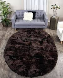 orange brown and beige area rug blue rugs for dark leather couch large oval shape chocolate sheepskin feet teal denver gray green grey x black kitchen