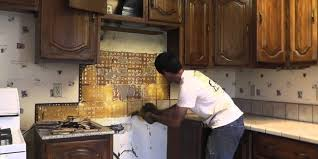 how to install granite countertops on a budget part 1 removing the old tile how to install a granite slab kitchen counter on the