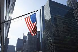American Flag And Office Buildings Manhattan New York Usa Blue