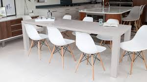 grey extending dining table and white eames style dining chairs