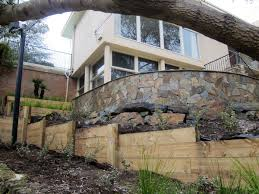 retaining walls can also help to shape or remove the need for a staircase or steps saving on space and additional cost