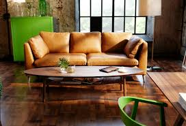 beige ikea leather sofa with oval coffee table on wood flooring for exciting