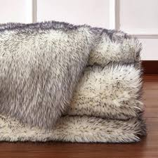 what is a throw rug faux fur rug rug factory plus faux fox white black area