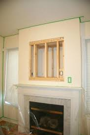 mounting tv above fireplace how to mount with no studs home decor plasma brick