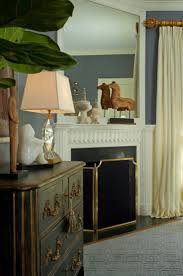elegant bedroom design featuring beautiful white fireplace mantel with brass fireplace screen