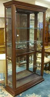 lot 1277 large lighted display cabinet w 4 side doors 2 glass shelves w plate grooves 43 1 4 in w 79 in h