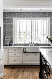 grey subway tiles all over the kitchen wall